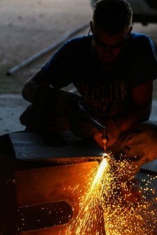 My brother, John, cutting metal